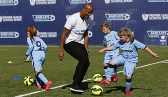 LONDON, ENGLAND - AUGUST 13: Vincent Kompany of Manchester City participates in a training session with young people during the Official Premier League Season Launch Media Event at Capital City Academy on August 13, 2014 in London, England. (Photo by Steve Bardens/Getty Images)